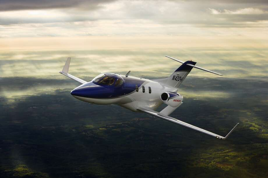 Honda's advanced light jet, HondaJet, features several innovations that help it achieve far better fuel efficiency, larger cabin and luggage space and higher cruise speed than conventional aircraft in its class. The result of 20 years of aviation research, key HondaJet innovations include a patented over-the-wing engine-mount configuration, a natural-laminar flow (NLF) wing and fuselage nose, and an advanced all-composite fuselage structure. Photo: Honda, Wieck