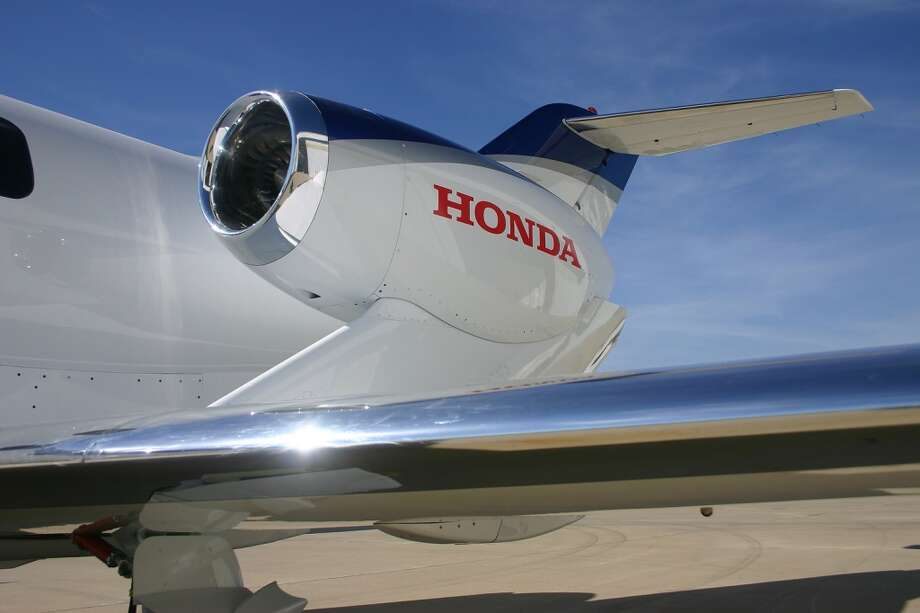 HondaJet's patented over-the-wing engine-mount configuration helps eliminate the need for a structure to mount the engines to the rear fuselage and, thus, maximizes the space in the fuselage. Positioning the HF-118 engines on the upper surfaces of the wing also reduces drag at high speed, improving fuel efficiency. Photo: Honda, Wieck
