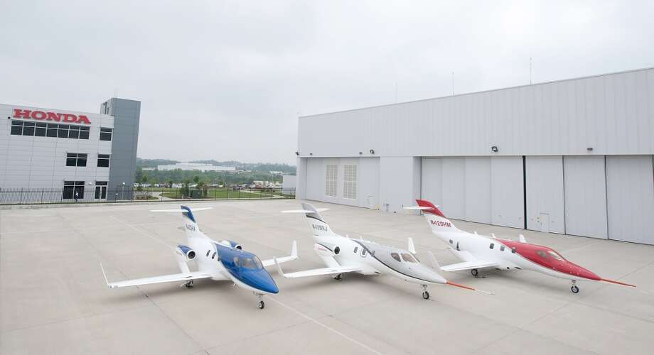 The third FAA-conforming HondaJet (right) debuts in brilliant HondaJet Red Pearl Metallic. This aircraft will join the first FAA-conforming HondaJet (center) in flight testing this summer. Also pictured is the original proof-of-concept HondaJet. Photo: Honda, Wieck
