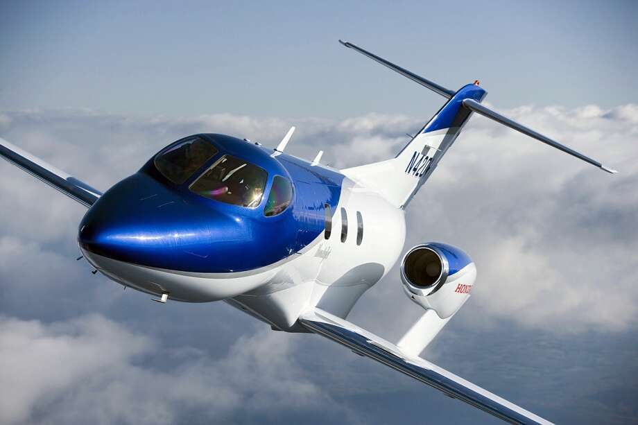 Honda's entry into the very light jet (VLJ) market, HondaJet, features several innovations that help it achieve far better fuel efficiency, larger cabin and luggage space and higher cruise speed than conventional aircraft in its class. The result of 20 years of aviation research, key HondaJet innovations include a patented over-the-wing engine-mount configuration, a natural-laminar flow (NLF) wing and fuselage nose, and an advanced all-composite fuselage structure. Photo: Honda, Wieck