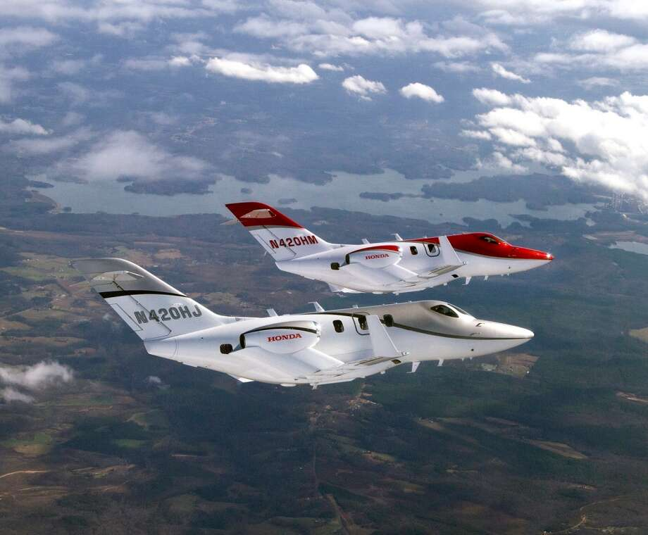 Honda Aircraft Company has completed one year of flight test with its FAA-conforming aircraft, F1, the silver aircraft in foreground, and its first month of flight test with F2, the red aircraft in background. Photo: Honda, Wieck