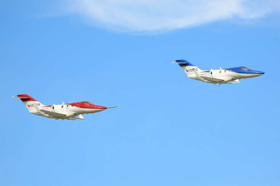 Two FAA-conforming HondaJets concluded the day with a formation fly over at the Experimental Aircraft Association's (EAA) AirVenture Oshkosh 2013 in Oshkosh, Wisc. Photo: Honda, Wieck
