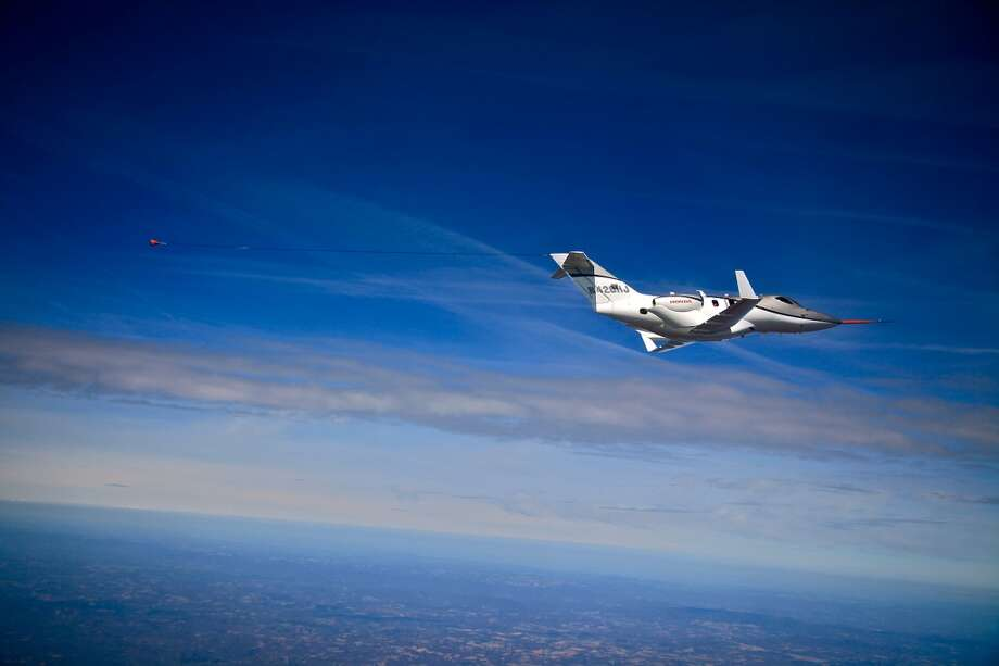 The HondaJet tows an airspeed calibration cone during flight testing. The FAA-conforming aircraft achieved a maximum speed of 425 KTAS on March 11, 2011. Photo: Honda, Wieck
