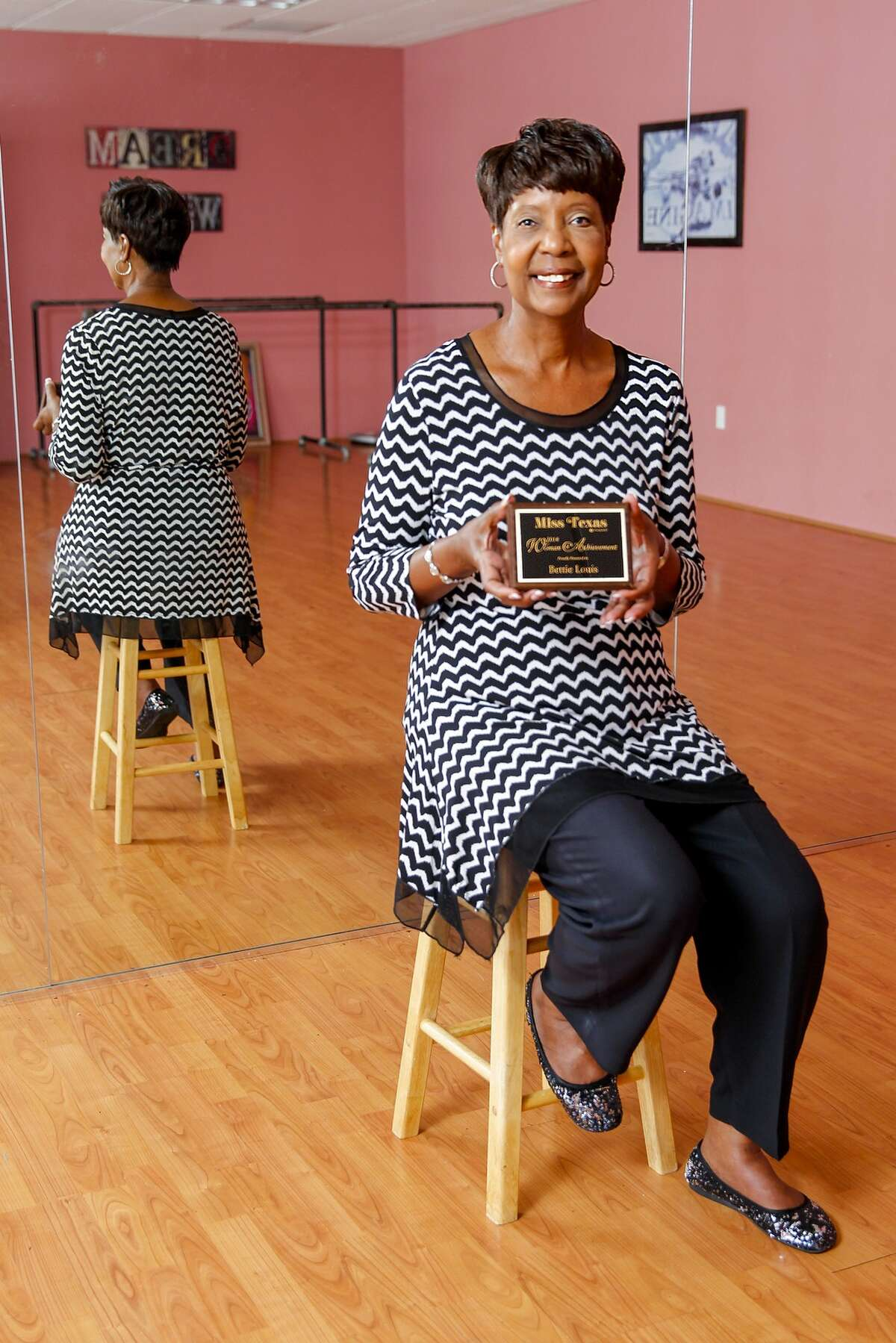 Bettie Louis of Pearland displays the Miss Texas Pageant Woman of Achievement Award for 2014 at Sheila Milner's dance studio, Dance Zone. Milner is Louis' daughter.