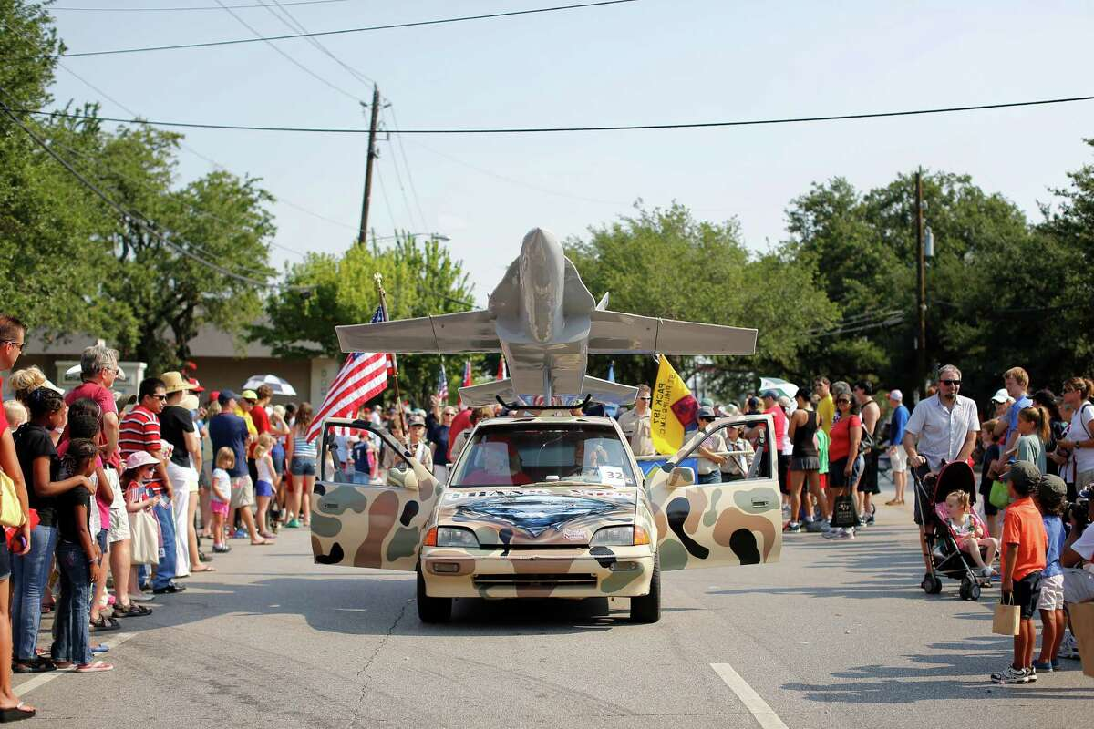 A motorized replica of a US Air Force fighter jet was mounted on the rear of a camouflaged car during last year's July Fourth parade in Bellaire.