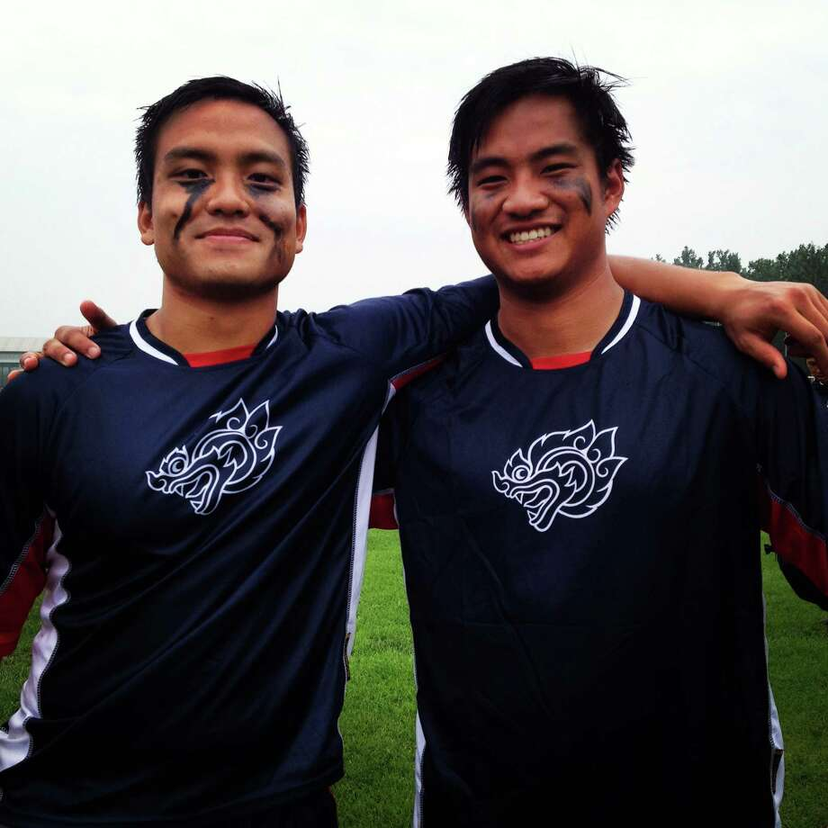 New Canaan brothers John and Chatch Sirisuth, right, pose after preparing for the 2014 World Lacrosse Championships in Denver, Colo. held from July 10-19. Photo: Contributed / New Canaan News Contributed