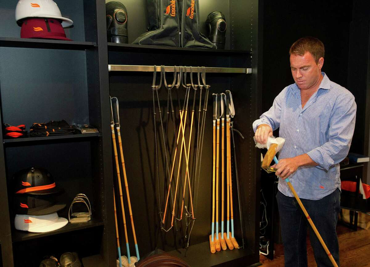 Co-owner Alejandro Viel unwraps a mallet at the newly opened Casablanca store on Greenwich Avenue in Greenwich, Conn., on Tuesday, July 1, 2014. The store sells equipment for polo players, including helmets, boots, and mallets, as well as luxury clothing.