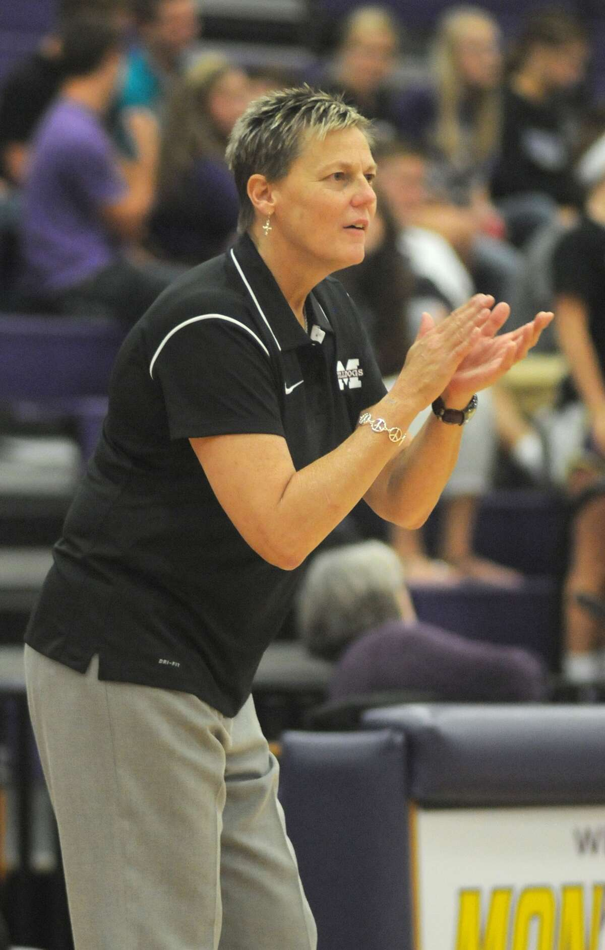 Magnolia Head Coach Terri Johnson pumps up her team against the Montgomery Lady Bears. Freelance photo by Jerry Baker