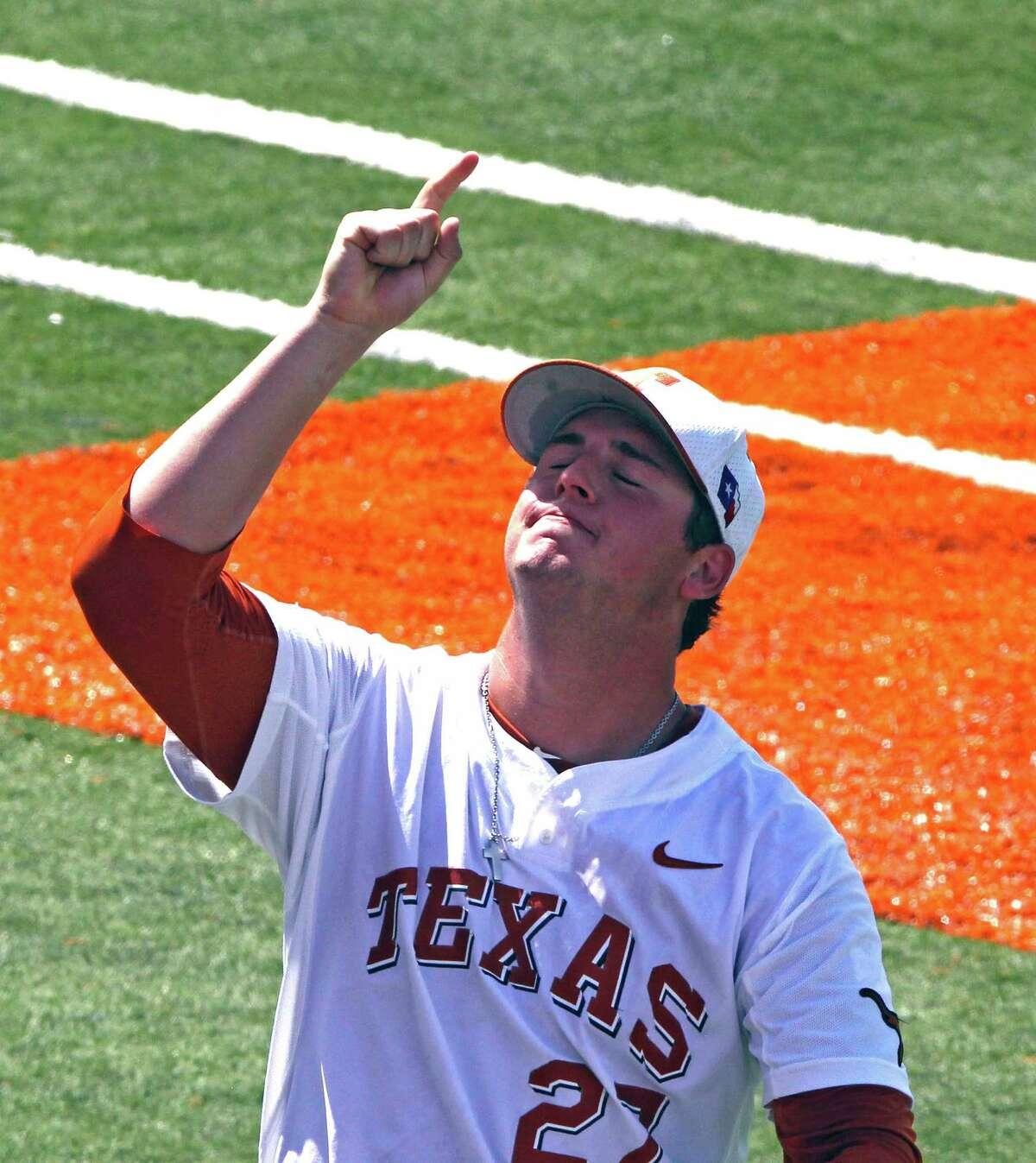 Texas' Travis Duke points to the sky after Texas defeats Houston in an NCAA college baseball super regional tournament in Austin, Texas, Sat., June 7, 2014. (AP Photo/Michael Thomas)