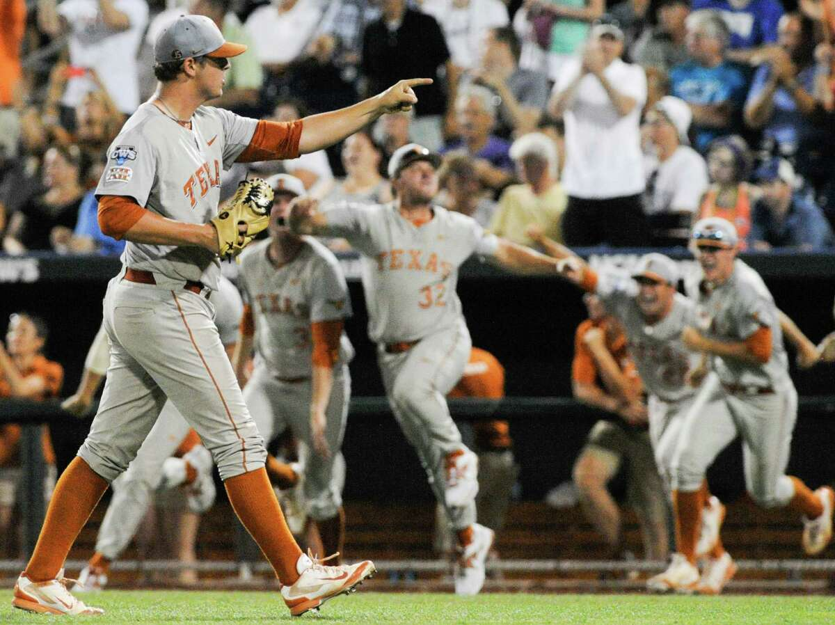 Texas pitcher Travis Duke points as texas players erupt from the dugout after the last out against UC Irvine, in an NCAA baseball College World Series elimination game in Omaha, Neb., Wednesday, June 18, 2014. Texas beat UC Irvine 1-0. (AP Photo/Eric Francis)