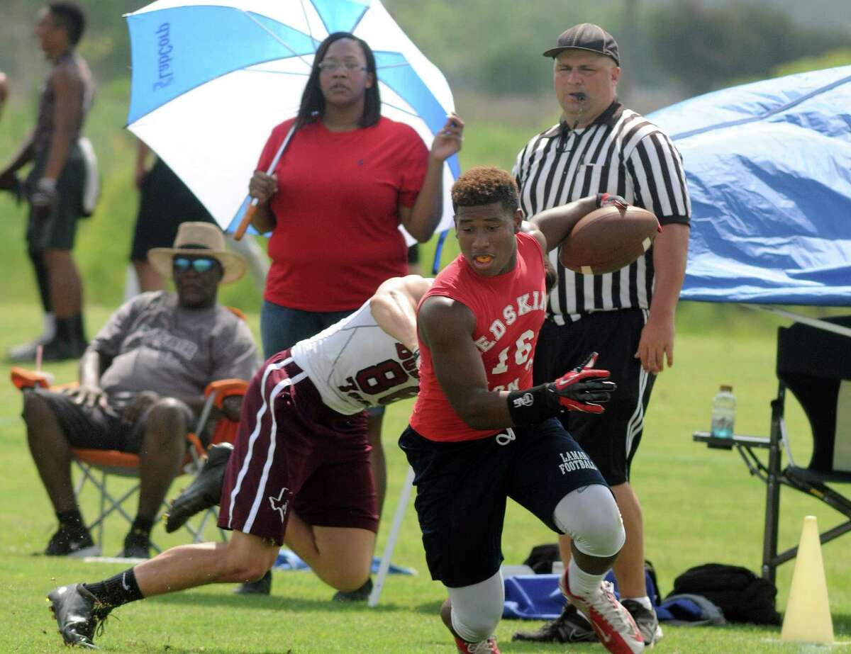 Lamar receiver D.J. Williams (16) made a play in front of a Cy-Fair defender during their pool play matchup at the CES Performance 7-on-7 football state qualifying tournament last month.