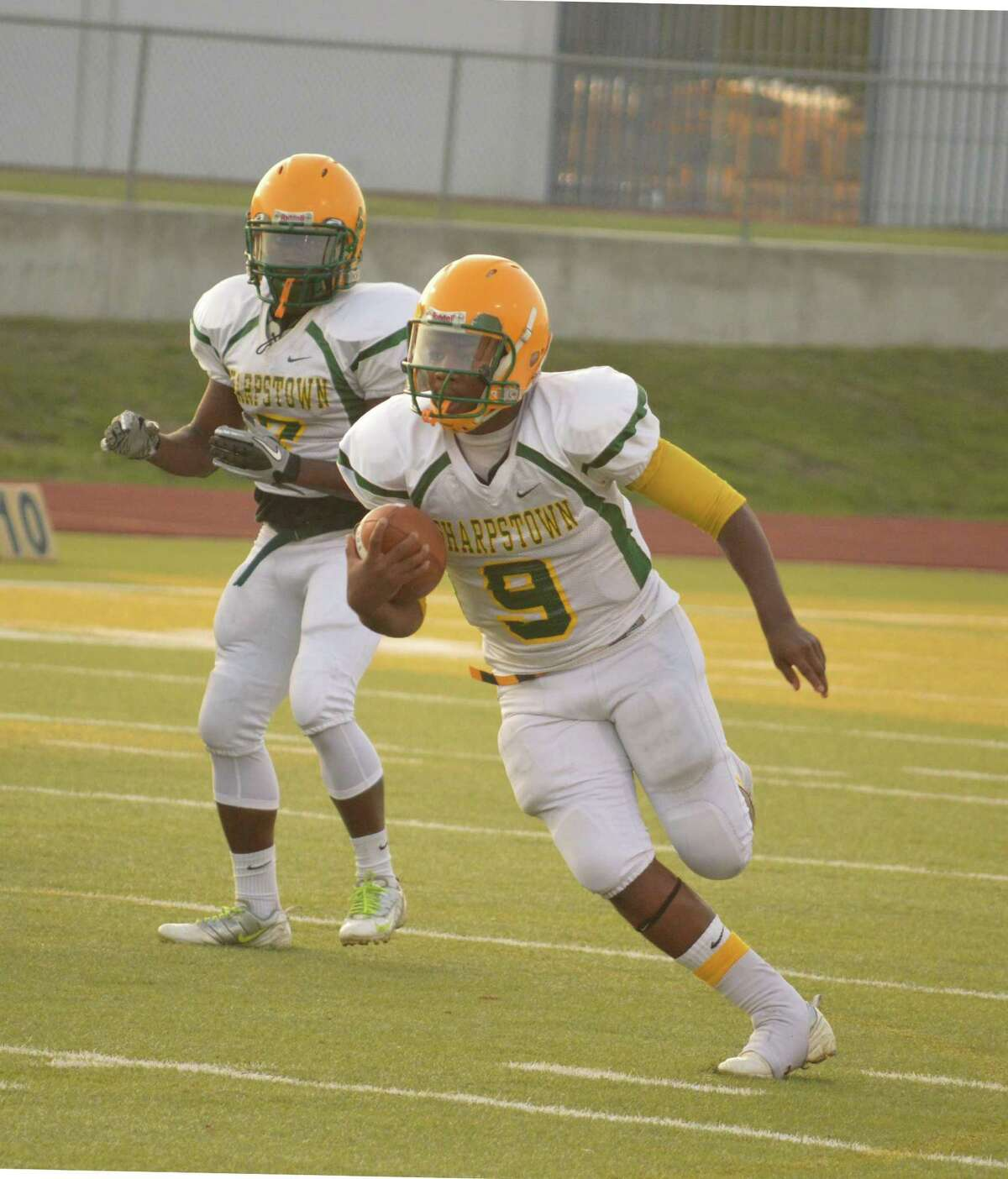 Number 9, Camern Allen makes a run against Sterling High School.