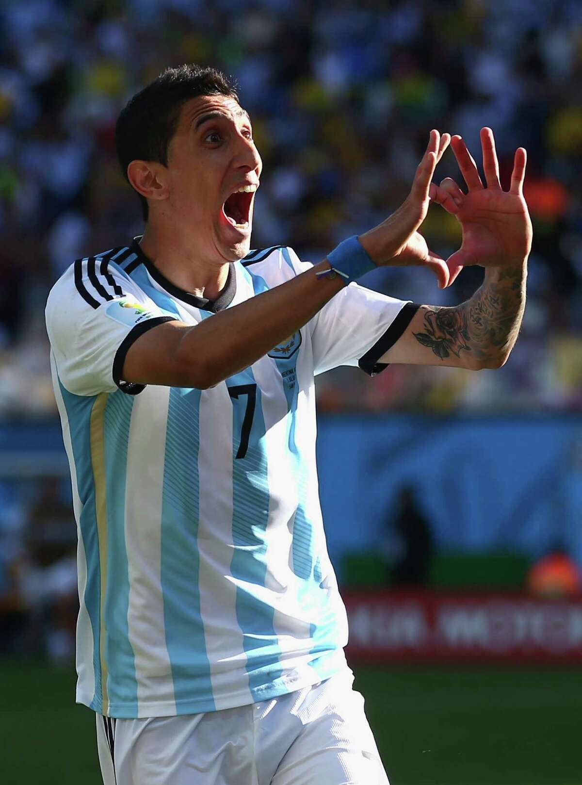 SAO PAULO, BRAZIL - JULY 01: Angel di Maria of Argentina celebrates scoring his team's first goal in extra time during the 2014 FIFA World Cup Brazil Round of 16 match between Argentina and Switzerland at Arena de Sao Paulo on July 1, 2014 in Sao Paulo, Brazil.