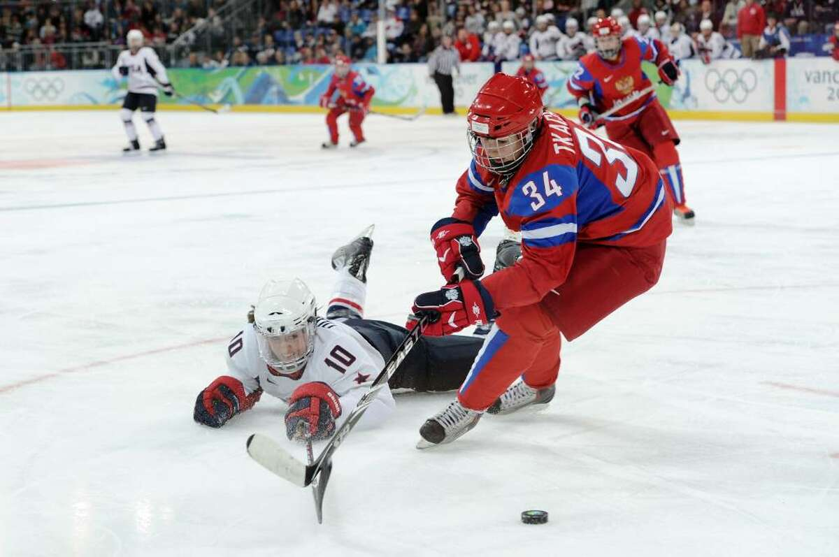 VANCOUVER, BC - FEBRUARY 16: Meghan Duggan of The United States flights for the puck with Svetlana Tkacheva of Russia during the women's ice hockey preliminary match between Russia and The United States at UBC Thunderbird Arena on February 16, 2010 in Vancouver, Canada. (Photo by Harry How/Getty Images) *** Local Caption *** Meghan Duggan;Svetlana Tkacheva