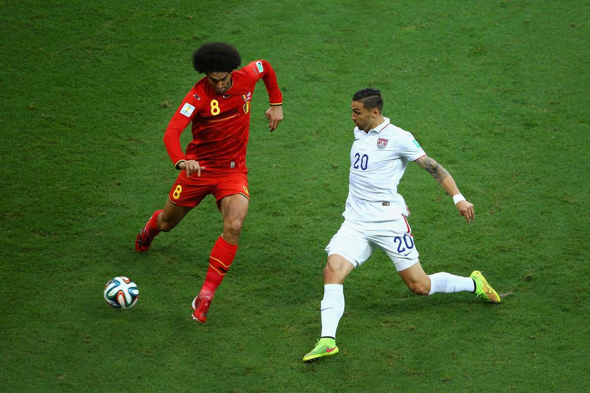 Geoff Cameron of the United States challenges Marouane Fellaini of Belgium during the 2014...