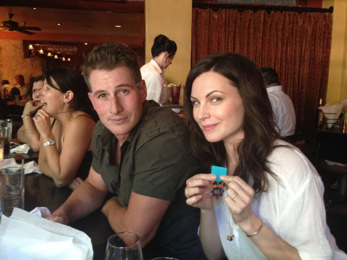 Jill Flint of 'The Night Shift' shows off her first Fiesta medal during dinner with her cast mates at Boudro's on the River Walk.