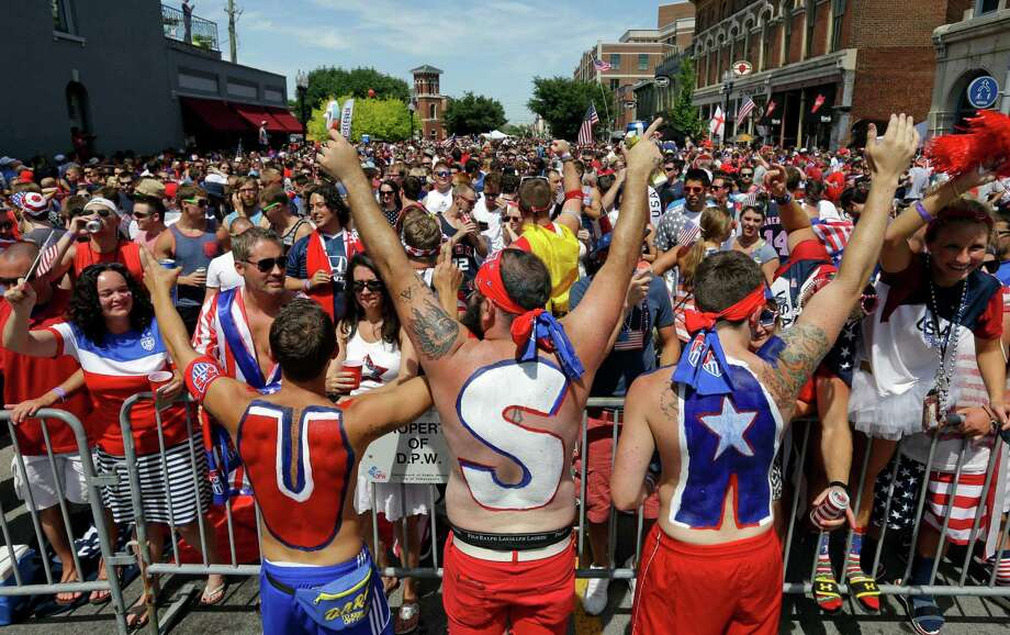 United States fans cheer before the start of the World Cup soccer match between the United States and Belgium at a viewing party in Indianapolis, Tuesday, July 1, 2014. (AP Photo/Michael Conroy) Photo: Michael Conroy, Associated Press / AP