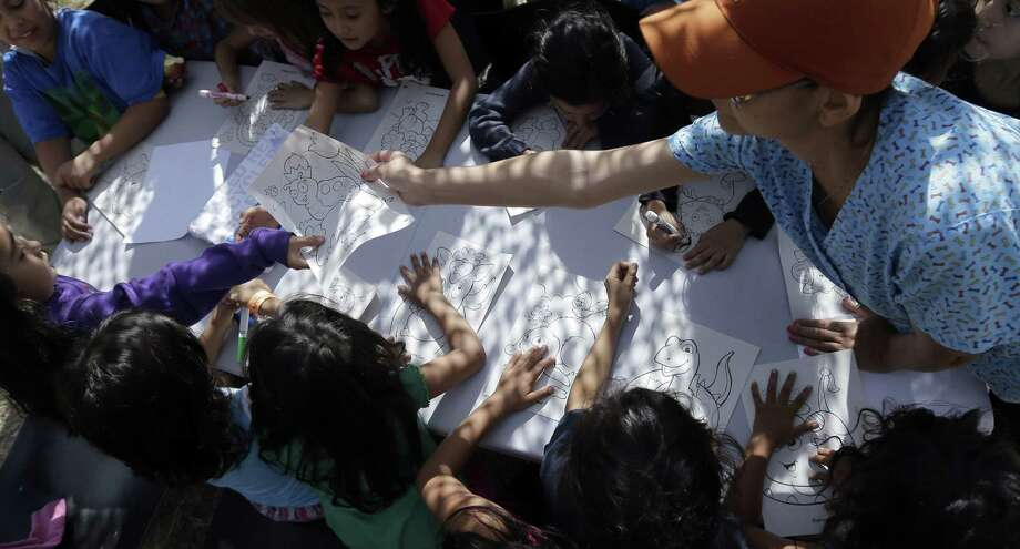 Children detainees color and draw at a U.S. Customs and Border Protection processing facility in Brownsville. What will our legacy be as we look back on how we welcomed or turned back children seeking safety? Photo: Eric Gay / Associated Press / POOL AP