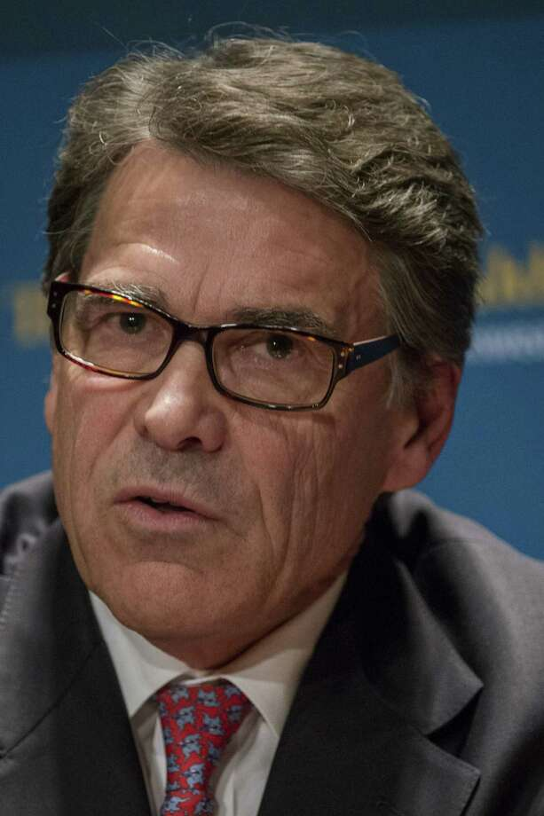 Texas Gov. Rick Perry says Washington has failed to address the state's border security problem. Photo: Bloomberg / © 2014 Bloomberg Finance LP