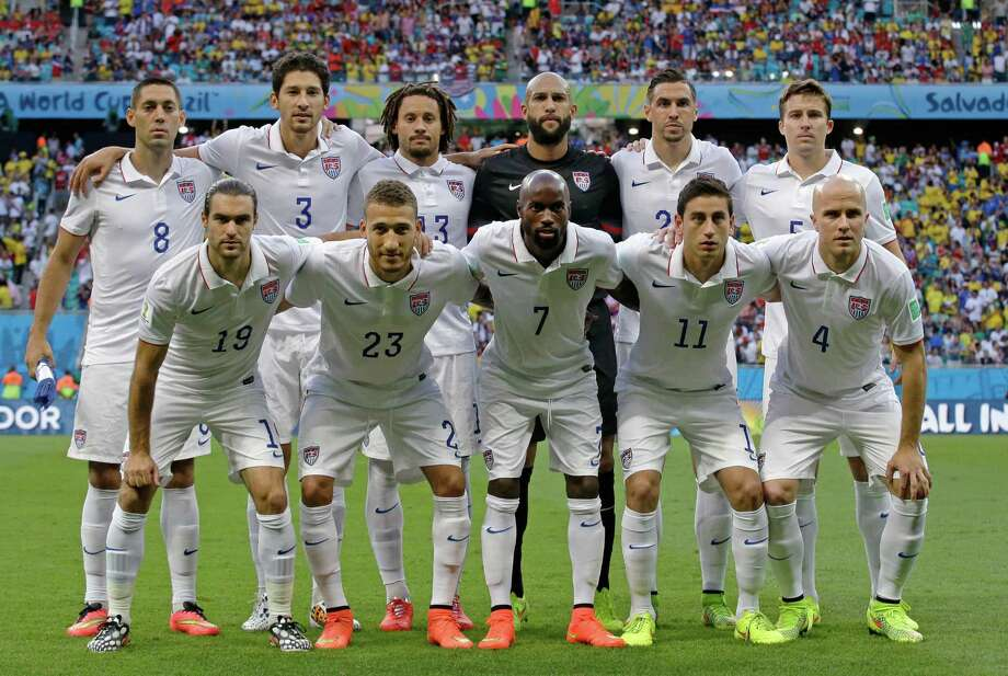 The United States team pose for a group photo before the World Cup round of 16 soccer match between Belgium and the USA at the Arena Fonte Nova in Salvador, Brazil, Tuesday, July 1, 2014. (AP Photo/Matt Dunham) Photo: Matt Dunham, Associated Press / AP