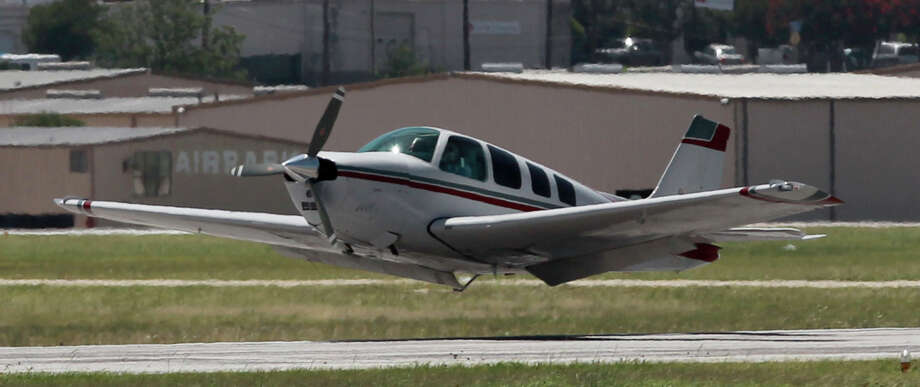 A small propeller plane makes an emergency belly landing Tuesday July 1, 2014 at the San Antonio International Airport. The passengers and pilot appeared to be safe. Photo: JOHN DAVENPORT, San Antonio Express-News / ©San Antonio Express-News/John Davenport