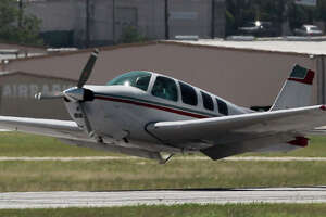 A small propeller plane makes an emergency belly landing Tuesday July 1, 2014 at the San Antonio International Airport. The passengers and pilot appeared to be safe.