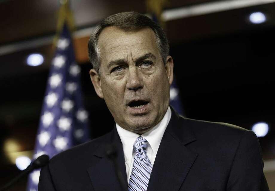 A reader takes House Speaker John Boehner of Ohio to task for his stance on climate change. Photo: J. Scott Applewhite / Associated Press / AP