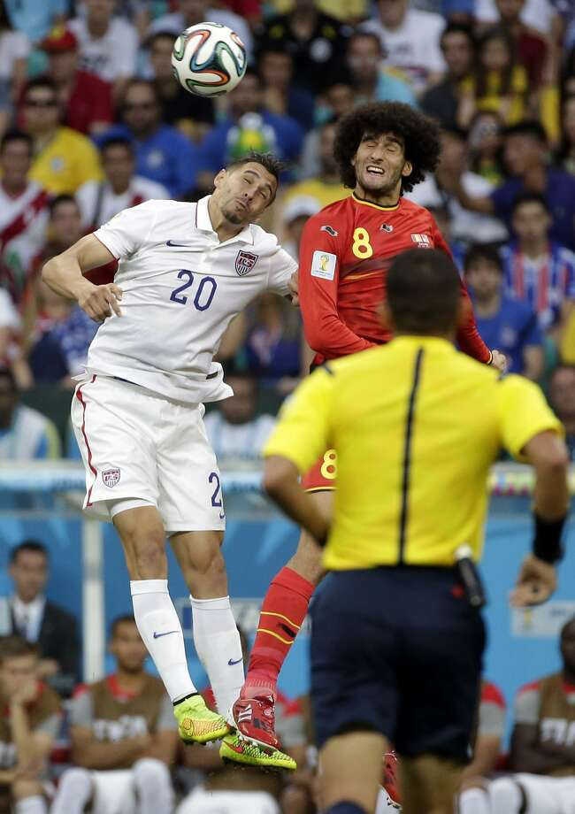 United States' Geoff Cameron (20) goes for a header with Belgium's Marouane Fellaini (8) during the World Cup round of 16 soccer match between Belgium and the USA at the Arena Fonte Nova in Salvador, Brazil, Tuesday, July 1, 2014. (AP Photo/Felipe Dana) Photo: Felipe Dana, Associated Press