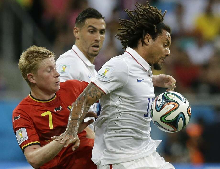 United States' Jermaine Jones, right, holds off Belgium's Kevin De Bruyne during the World Cup round of 16 soccer match between Belgium and the USA at the Arena Fonte Nova in Salvador, Brazil, Tuesday, July 1, 2014. (AP Photo/Matt Dunham) Photo: Matt Dunham, Associated Press