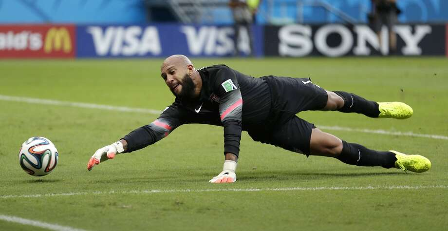 United States' goalkeeper Tim Howard stretches to make a save during the World Cup round of 16 soccer match between Belgium and the USA at the Arena Fonte Nova in Salvador, Brazil, Tuesday, July 1, 2014. (AP Photo/Julio Cortez) Photo: Julio Cortez, Associated Press