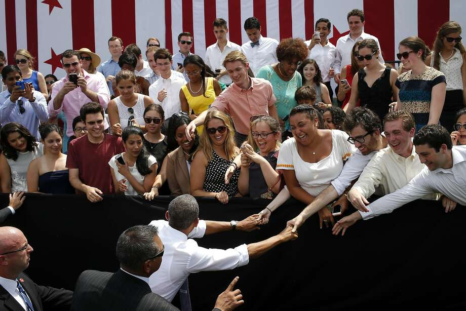 President Obama greets audience members after speaking about transportation and the economy at Georgetown Waterfront Park, on the Potomac River in Washington. Photo: Charles Dharapak, Associated Press