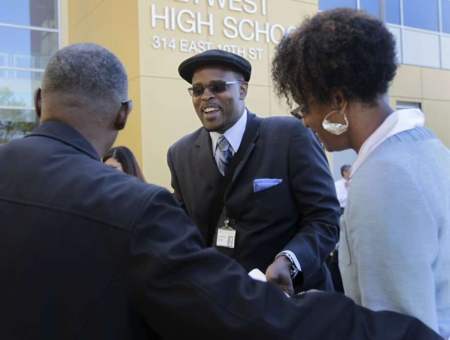 New Oakland Superintendent Antwan Wilson (center) greets Bruce Cox and board member Jumoke Hinton Hodge. Photo: Paul Chinn, The Chronicle