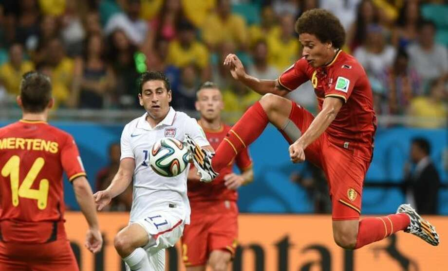 US midfielder Alejandro Bedoya (C) vies with Belgium's midfielder Axel Witsel during a Round of 16 football match between Belgium and USA at Fonte Nova Arena in Salvador during the 2014 FIFA World Cup on July 1, 2014.      AFP PHOTO/ FRANCISCO LEONGFRANCISCO LEONG/AFP/Getty Images Photo: FRANCISCO LEONG, AFP/Getty Images