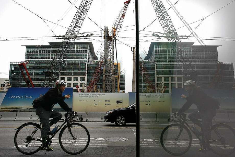 A man rides his bike past the site of the future Transbay Terminal on 415 Mission St. in San Francisco, Calif. on Wednesday, June 25,  2015, 2014. The Transbay Terminal will not be able to open with a public rooftop park without the aide of the private sector. Photo: James Tensuan, The Chronicle
