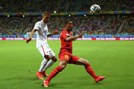 SALVADOR, BRAZIL - JULY 01:  Eden Hazard of Belgium controls the ball as Fabian Johnson of the United States gives chase during the 2014 FIFA World Cup Brazil Round of 16 match between Belgium and the United States at Arena Fonte Nova on July 1, 2014 in Salvador, Brazil. Photo: Michael Steele, Getty Images / 2014 Getty Images