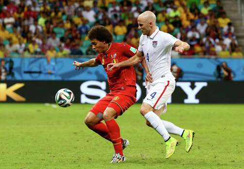 SALVADOR, BRAZIL - JULY 01:  Michael Bradley of the United States challenges Axel Witsel of Belgium during the 2014 FIFA World Cup Brazil Round of 16 match between Belgium and the United States at Arena Fonte Nova on July 1, 2014 in Salvador, Brazil. Photo: Kevin C. Cox, Getty Images / 2014 Getty Images