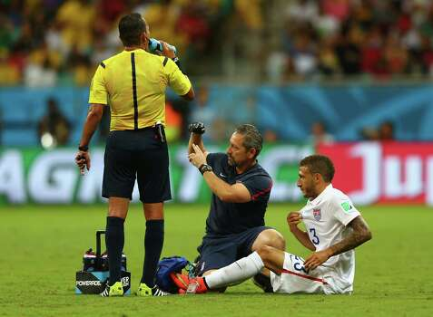 SALVADOR, BRAZIL - JULY 01: Fabian Johnson of the United States receives treatment during the 2014 FIFA World Cup Brazil Round of 16 match between Belgium and the United States at Arena Fonte Nova on July 1, 2014 in Salvador, Brazil. Photo: Michael Steele, Getty Images / 2014 Getty Images