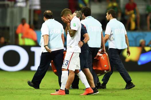 SALVADOR, BRAZIL - JULY 01: Fabian Johnson of the United States is helped off the field during the 2014 FIFA World Cup Brazil Round of 16 match between Belgium and the United States at Arena Fonte Nova on July 1, 2014 in Salvador, Brazil. Photo: Laurence Griffiths, Getty Images / 2014 Getty Images