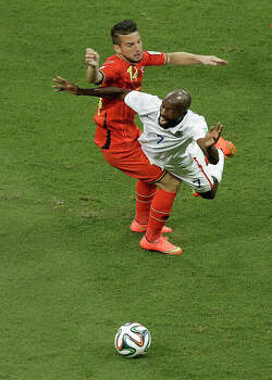 United States' DaMarcus Beasley is airborne after colliding with Belgium's Dries Mertens during the World Cup round of 16 soccer match between Belgium and the USA at the Arena Fonte Nova in Salvador, Brazil, Tuesday, July 1, 2014. (AP Photo/Themba Hadebe) Photo: Themba Hadebe, Associated Press / AP