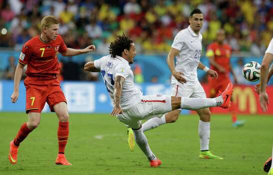 United States' Jermaine Jones, right, clears the ball from Belgium's Kevin De Bruyne during the World Cup round of 16 soccer match between Belgium and the USA at the Arena Fonte Nova in Salvador, Brazil, Tuesday, July 1, 2014. (AP Photo/Matt Dunham) Photo: Matt Dunham, Associated Press / AP