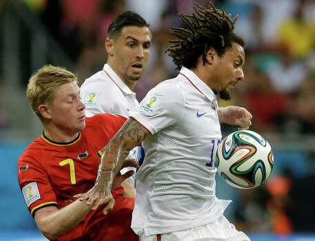 United States' Jermaine Jones, right, holds off Belgium's Kevin De Bruyne during the World Cup round of 16 soccer match between Belgium and the USA at the Arena Fonte Nova in Salvador, Brazil, Tuesday, July 1, 2014. (AP Photo/Matt Dunham) Photo: Matt Dunham, Associated Press / AP