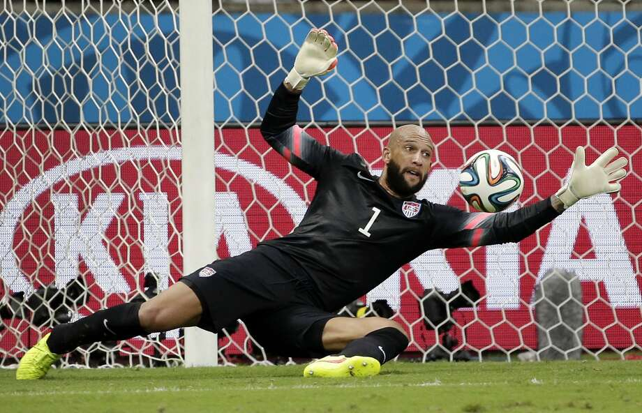 United States' goalkeeper Tim Howard saves a shot by Belgium during the World Cup round of 16 soccer match between Belgium and the USA at the Arena Fonte Nova in Salvador, Brazil, Tuesday, July 1, 2014. (AP Photo/Felipe Dana) Photo: Felipe Dana, Associated Press