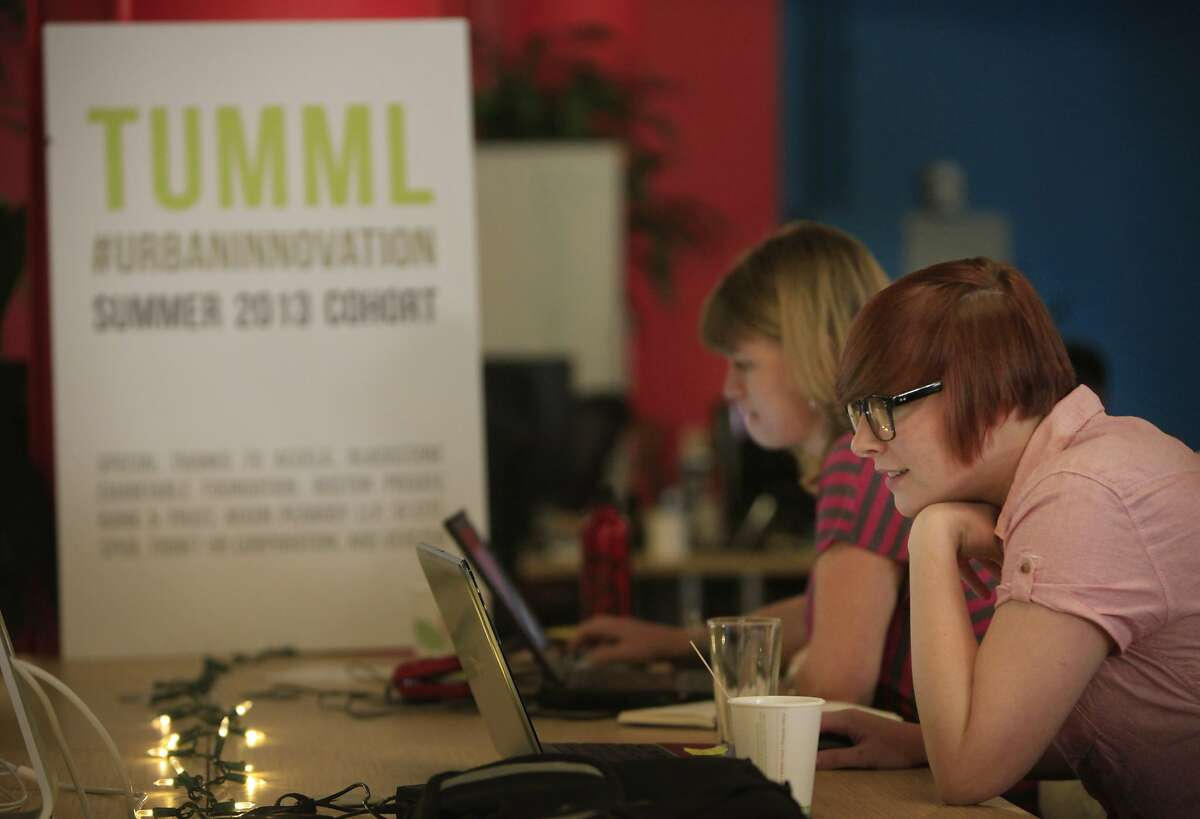 Renee Jutras (foreground to background), lead data scientist Valor and Christine Boyle, president Valor work on their laptops on the first day of Tumml's Summer 2014 Cohort in the Tumml office on Monday, June 9, 2014 in San Francisco, Calif.