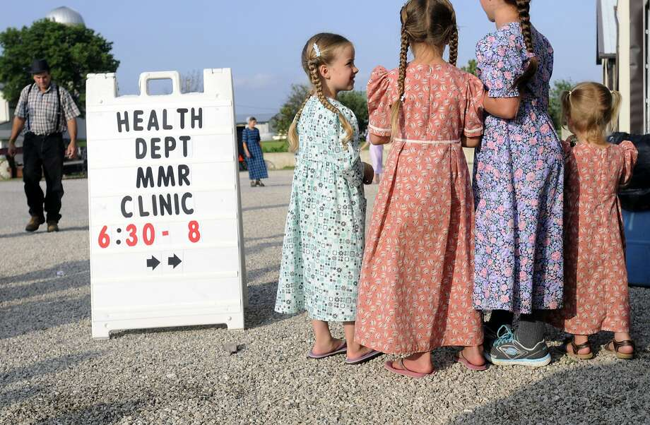 Young Mennonites, who have a lifestyle similar to the Amish, gather at a health clinic in Shiloh, Ohio. Photo: Tom E. Puskar, Associated Press
