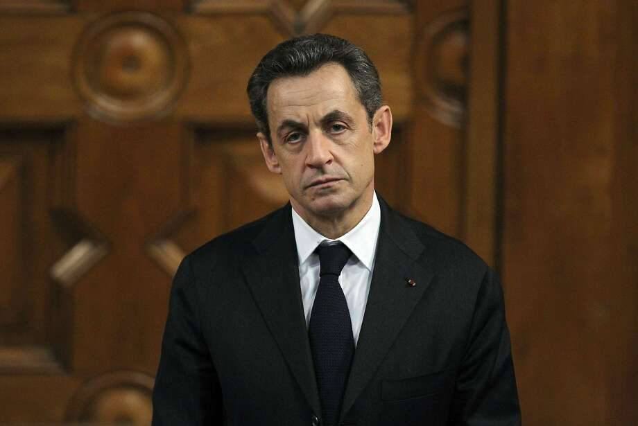 (FILES) - A photo taken on March 9, 2012 in Nice, southeastern France, shows Frances incumbent president and UMP ruling party candidate for the 2012 presidential election Nicolas Sarkozy waiting before delivering a speech at the Mediterranean Center University during a campaign visit. Nicolas Sarkozy was on July 1st, 2014 detained for questioning in a corruption probe, a judicial source told, in an unprecedented move against a former French president. Anti-corruption investigators can hold Sarkozy for questioning for up to 24 hours, with a possible extension of another day.    AFP PHOTO / VALERY HACHEVALERY HACHE/AFP/Getty Images Photo: Valery Hache, AFP/Getty Images