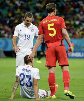 Belgium's Jan Vertonghen (5) and United States' Graham Zusi (19) comfort United States' Fabian Johnson (23) after he was injured during the World Cup round of 16 soccer match between Belgium and the USA at the Arena Fonte Nova in Salvador, Brazil, Tuesday, July 1, 2014. (AP Photo/Felipe Dana) Photo: Felipe Dana, Associated Press / AP