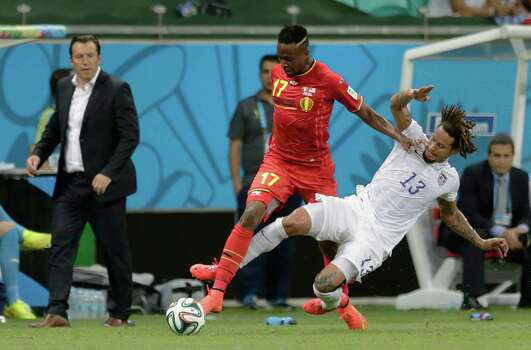 Belgium's head coach Marc Wilmots, left, watches as Belgium's Divock Origi gets away from United States' Jermaine Jones during the World Cup round of 16 soccer match between Belgium and the USA at the Arena Fonte Nova in Salvador, Brazil, Tuesday, July 1, 2014. (AP Photo/Julio Cortez) Photo: Julio Cortez, Associated Press / AP