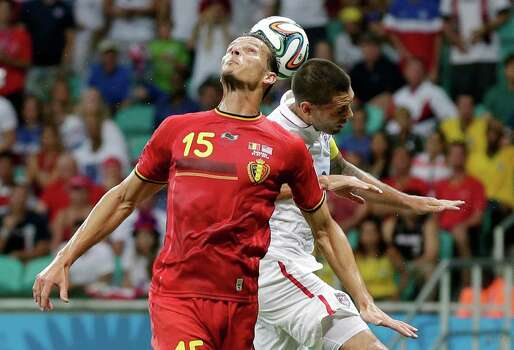 United States' Clint Dempsey heads the ball against Belgium's Daniel Van Buyten during the World Cup round of 16 soccer match between Belgium and the USA at the Arena Fonte Nova in Salvador, Brazil, Tuesday, July 1, 2014. (AP Photo/Marcio Jose Sanchez) Photo: Marcio Jose Sanchez, Associated Press / AP