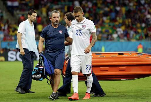 United States' Fabian Johnson (23) leaves the pitch after being injured during the World Cup round of 16 soccer match between Belgium and the USA at the Arena Fonte Nova in Salvador, Brazil, Tuesday, July 1, 2014. (AP Photo/Felipe Dana) Photo: Felipe Dana, Associated Press / AP