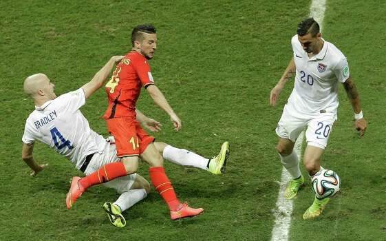 Belgium's Dries Mertens, center, is challenged by United States' Michael Bradley, left, and Geoff Cameron during the World Cup round of 16 soccer match between Belgium and the USA at the Arena Fonte Nova in Salvador, Brazil, Tuesday, July 1, 2014. (AP Photo/Themba Hadebe) Photo: Themba Hadebe, Associated Press / AP
